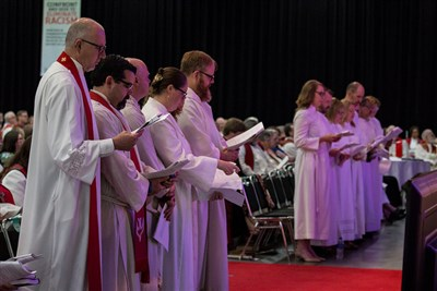 Clergy being ordained, commissioned, or recgonized follow the order of service in scripts during the Celebration of Life in Ministry Service at the 2018 Minnesota Annual Conference.